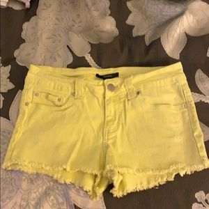 Neon green denim cut off shorts